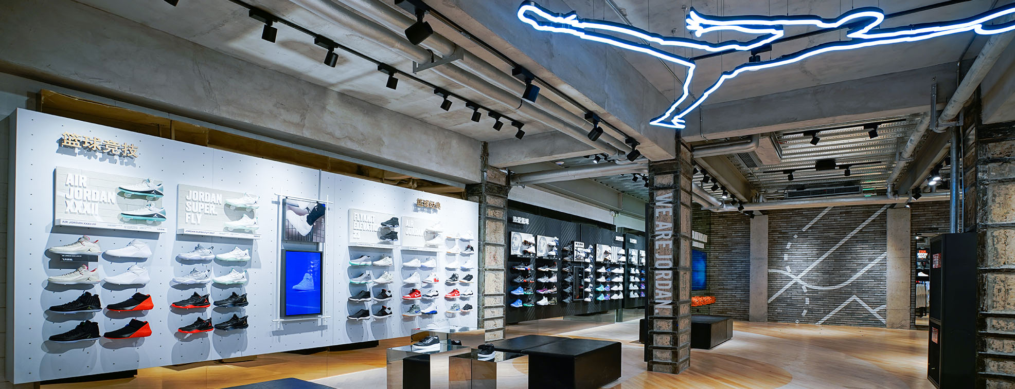 Sport shoe shop with chairs and numerous shelves