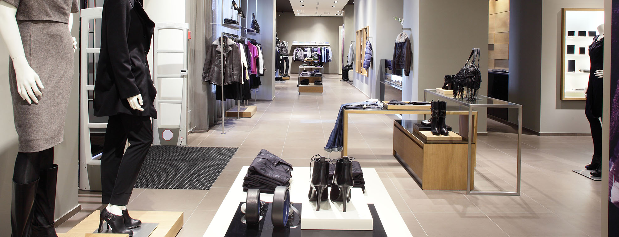 Luxurious store layout with simple shelves and tables in the middle