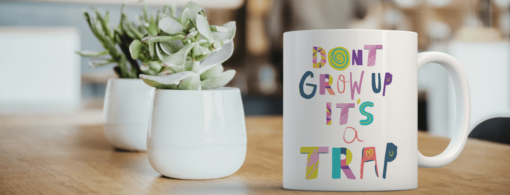 "Cool custom white mug on a table with ""Don't grow up it's a trap"" written on it"